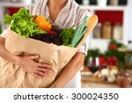 young woman holding grocery... | Shutterstock . vector #300024350