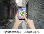 woman left hand holding smart... | Shutterstock . vector #300063878