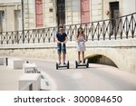 happy young couple riding... | Shutterstock . vector #300084650