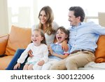happy family watches movie... | Shutterstock . vector #300122006