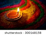 traditional diya lamp lit on... | Shutterstock . vector #300168158
