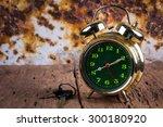 Retro Alarm Clock On Wood Tabl...