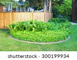 Small photo of ANCASTER, ONTARIO - JULY 12, 2015: Suburban lawn, Ancaster, Ontario. Ancaster is a community located on the Niagara Escarpment that amalgamated with the city of Hamilton, Ontario, Canada in 2001