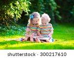 kids reading a book in summer... | Shutterstock . vector #300217610
