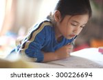 asian young girl read a book   Shutterstock . vector #300226694