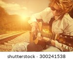 guy with guitar on the railway | Shutterstock . vector #300241538