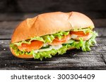 sandwich with salmon patty and... | Shutterstock . vector #300304409