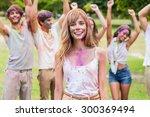 happy friends throwing powder... | Shutterstock . vector #300369494