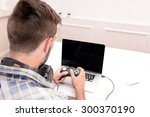 young man playing computer... | Shutterstock . vector #300370190