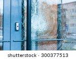 broken glass front door | Shutterstock . vector #300377513