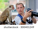 photographer shows a monkey by... | Shutterstock . vector #300401249