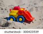 Toy Excavator In The Sand