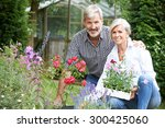 Mature Couple Planting Out...