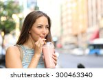 Pensive Happy Woman Sipping A...