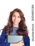 Small photo of Feeling brisk. Vivacious beautiful young girl folding her hands and holding laptop while standing isolated on white background.
