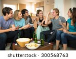 Stock photo group crowd of people friends at home in dorm playing games cards poker excited 300568763