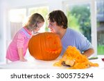 Family Carving Pumpkin At...