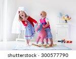two children play indoors. kids ... | Shutterstock . vector #300577790