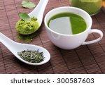 Green tea n the brown mat close ...