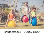 Dad And Children Playing On Th...