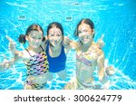 Family Swim In Pool Underwater  ...