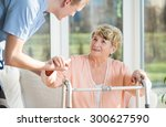 man helps to stand up an older... | Shutterstock . vector #300627590