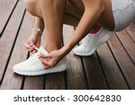 woman lacing fitness and sport... | Shutterstock . vector #300642830