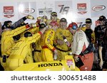 Newton, Iowa USA - July 18, 2015: Verizon IndyCar Series Iowa Corn Indy 300. Ryan Hunter-Reay gets a shower of Snapple from his crew after winning the race. - stock photo