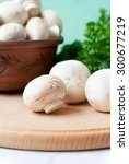 raw mushrooms in a bowl on the... | Shutterstock . vector #300677219