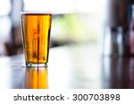pint glass of india pale ale on ...   Shutterstock . vector #300703898