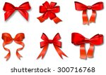 set of red gift bows with... | Shutterstock .eps vector #300716768