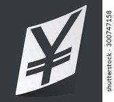white sticker with black yen...