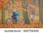 happy active woman riding bike... | Shutterstock . vector #300756500