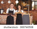 Portrait Of Smiling Waiter And...