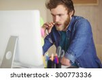 focused hipster working at his... | Shutterstock . vector #300773336