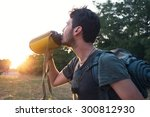 adventurer hiker drinking fresh ... | Shutterstock . vector #300812930