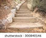 Wooden Steps Going Up A Hill...