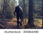 Ranger In Autumn Forest...