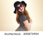 happy girl over ocher background | Shutterstock . vector #300874904