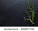 rosemary herb on stone table.... | Shutterstock . vector #300897740