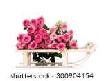 Roses On A Wooden Sleigh On...