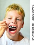 eating red boy with spoon near... | Shutterstock . vector #300960998