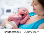 mother giving birth to a baby.... | Shutterstock . vector #300996074