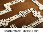 domino game tiles on wooden...