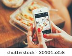woman hand taking photo food by ... | Shutterstock . vector #301015358