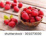 red raspberries on grey wooden... | Shutterstock . vector #301073030