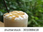 caramel syrup on ice coffee... | Shutterstock . vector #301088618