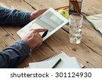 tablet computer in men hands....   Shutterstock . vector #301124930