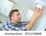 man fitting an air vent | Shutterstock . vector #301145888