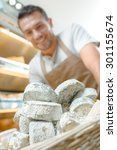 Cheese Shop Worker With New...